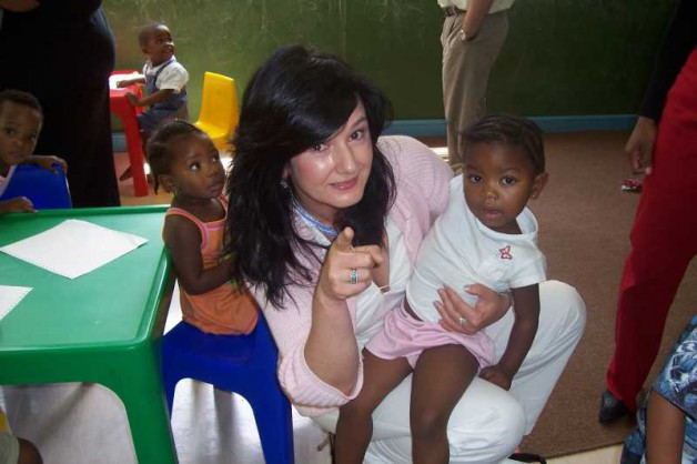 Professor Taylor visiting children at a a special accommodation and care service for children in Johannesburg, South Africa