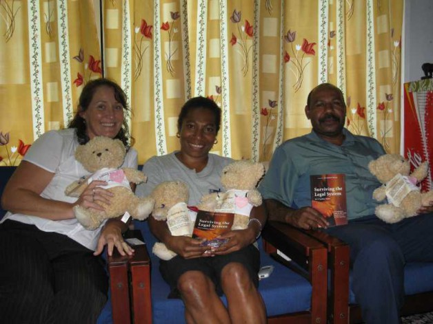 CT Bear goes to the Port Moresby Women and Children's Family Violence Centre to help children of all ages. He is seen here with AusAid workers; PNG police and social worker from the centre